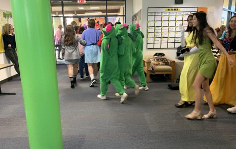 Seniors walk through in the Upper School in costume. Photo by Sonia Dhingra.
