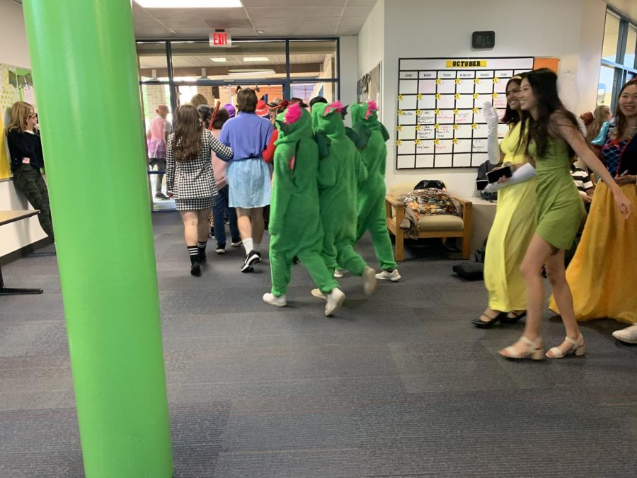 Seniors walk through in the Upper School in costume. Photo by Sonia Dhingra.