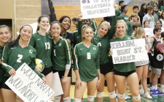 Members of the girls' volleyball team cheer on the boys' volleyball team during their Homecoming game against St. Marks. Photo courtesy of Meredith Roberts.