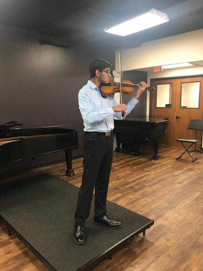 Sophomore Pranav Mukund playing his violin. Photo courtesy of Pranav Mukund.