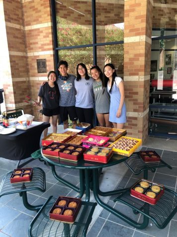 Leaders of the East Asian Affinity Group, shown here  handing out mooncakes during the Upper School's Mid-Autumn Festival, have criticized acts of discrimination and xenophobia directed at Asian Americans during the Covid-19 pandemic. Sophomore Ashley Shan, far right,  has questioned whether Greenhill School has done enough to support East Asian students.
