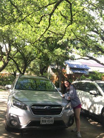Sophomore Megan Zlotky posing with her car on her birthday.
