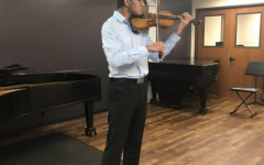 Junior Pranav Mukund playing his violin.