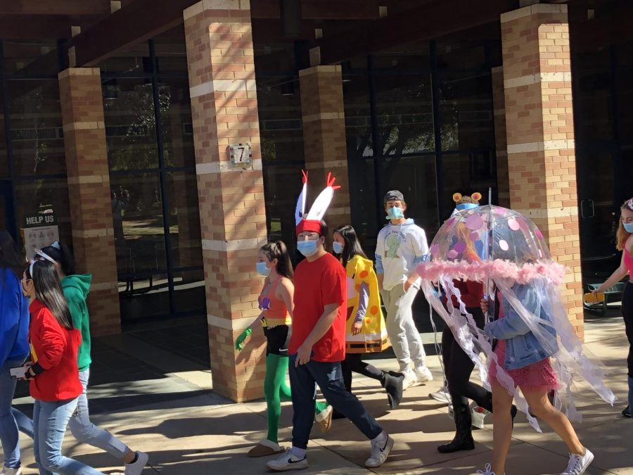 A group of seniors dressed as characters from Spongebob make their way through the parade.