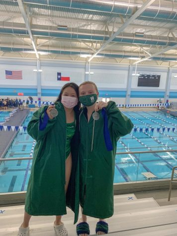 Seniors Victoria Le and Lane Herbert with silver medals from the Girls 400 yd Free relay event. Swimmers took to the pools for the SPC North Zone meet which was postponed twice due to weather.