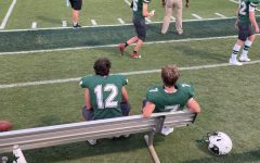 Bennett Broaddus (22) and Gideon Myers (22) sitting on the bench during the football game against St. Johns School.