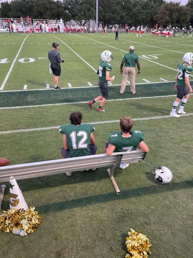 Bennett Broaddus ('22) and Gideon Myers ('22) sitting on the bench during the football game against St. John's School.