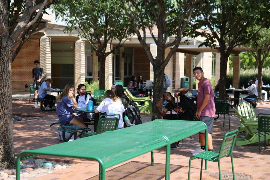 Seniors in courtyard during break.